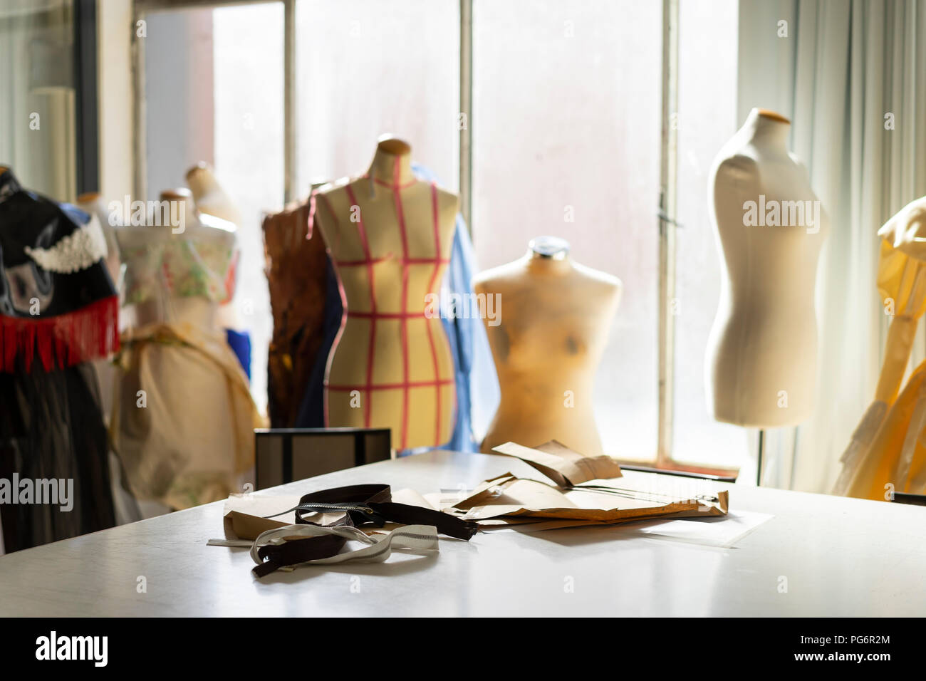 Dressmaker's models in fashion designer's studio - Stock Image