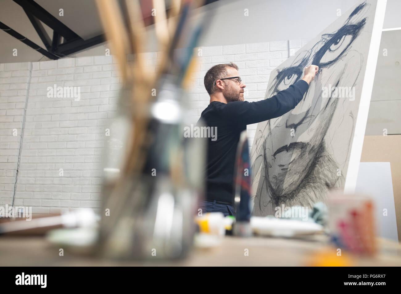 Man checking drawing in studio - Stock Image