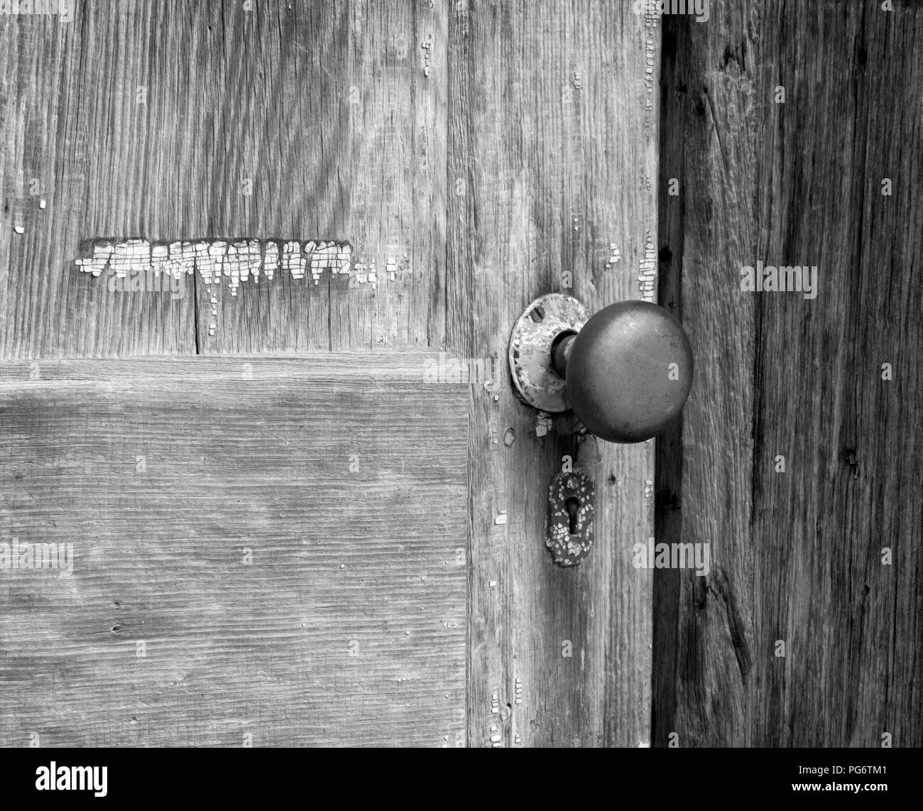 Weathered door in the ghost town of Bannack, Montana, the United States - Stock Image