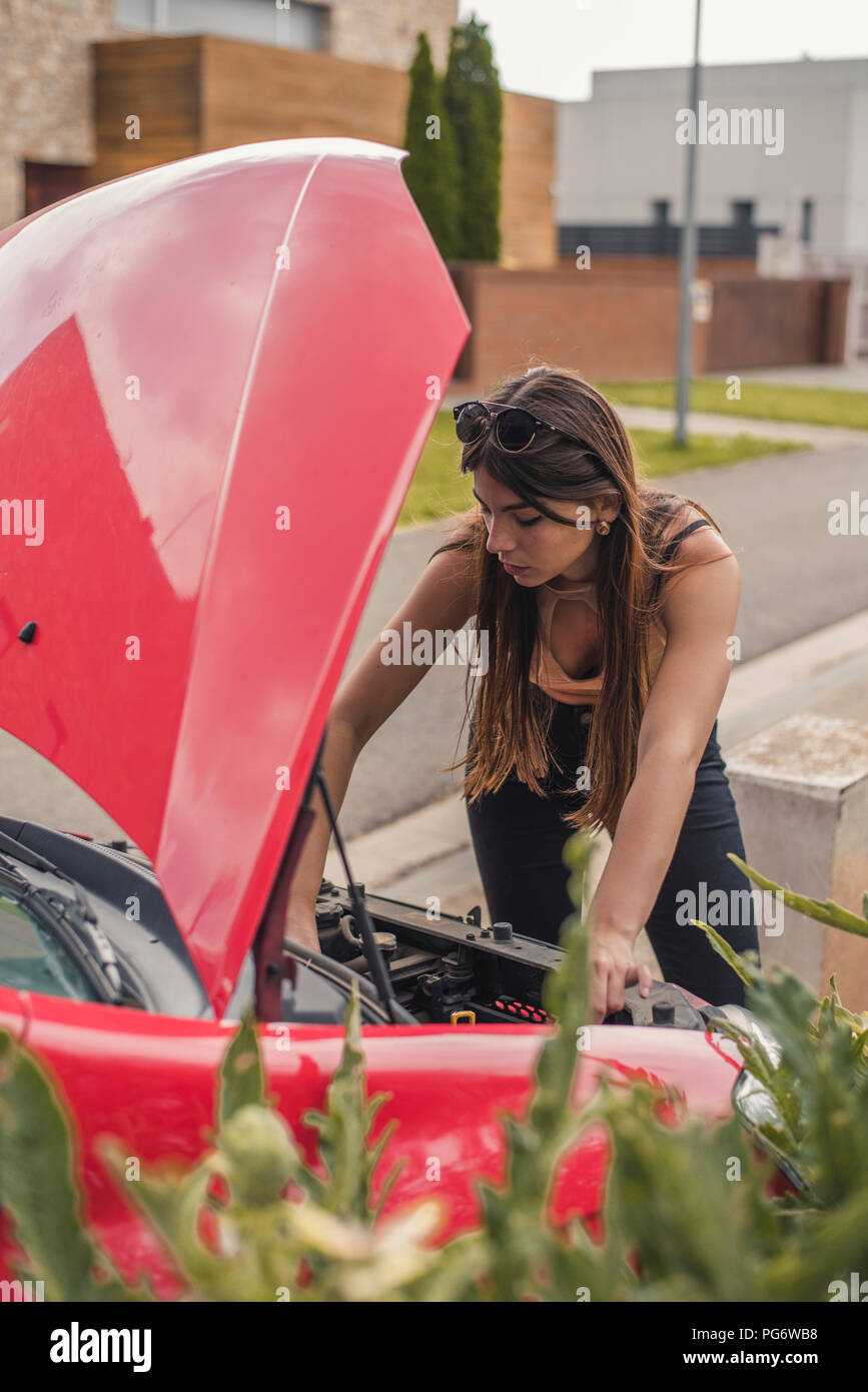 Young woman having a car breakdown - Stock Image