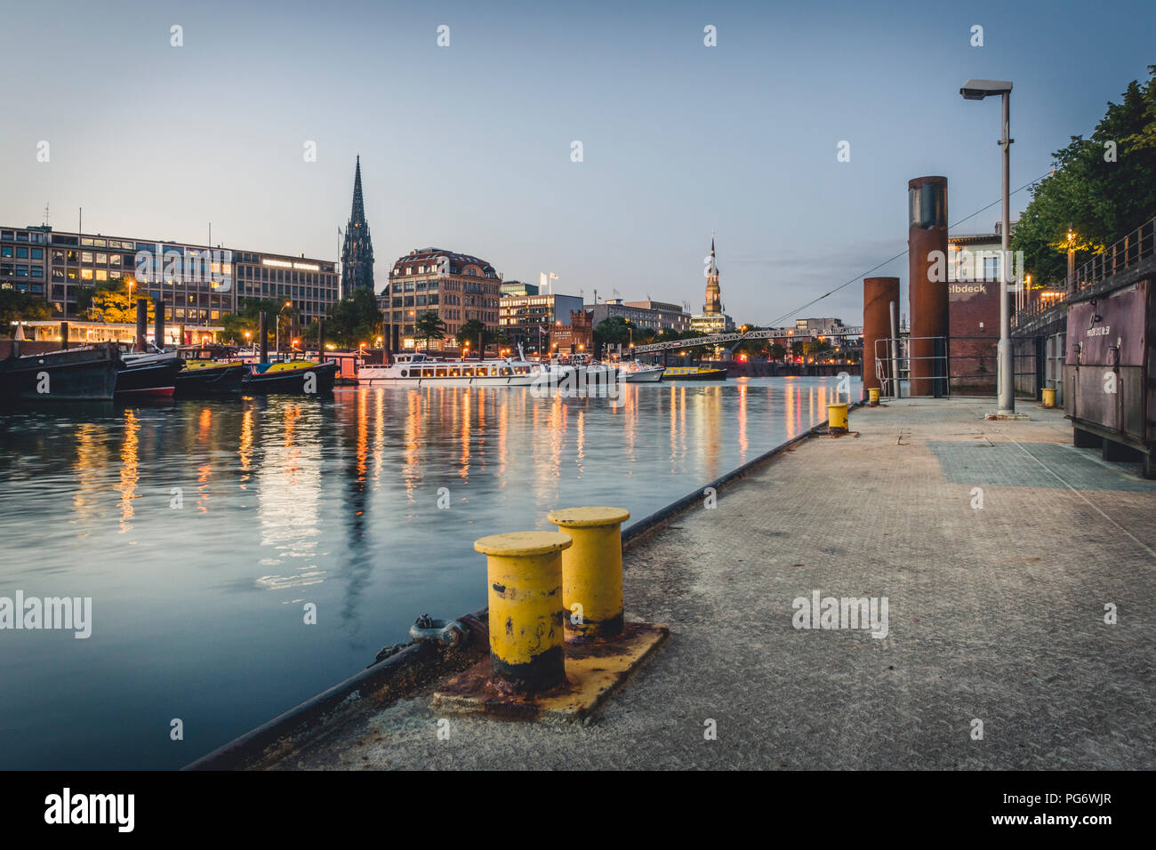 Germany, Hamburg, inland harbour and cityscape at blue hour - Stock Image