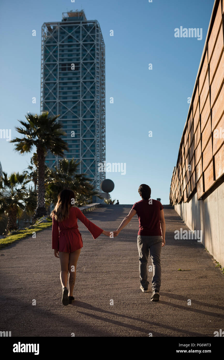 Spain, Barcelona, couple walking hand in hand  in the city Stock Photo