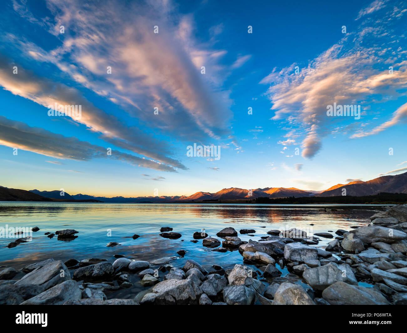 New Zealand, South Island, Canterbury Region, Lake Tekapo at sunset - Stock Image