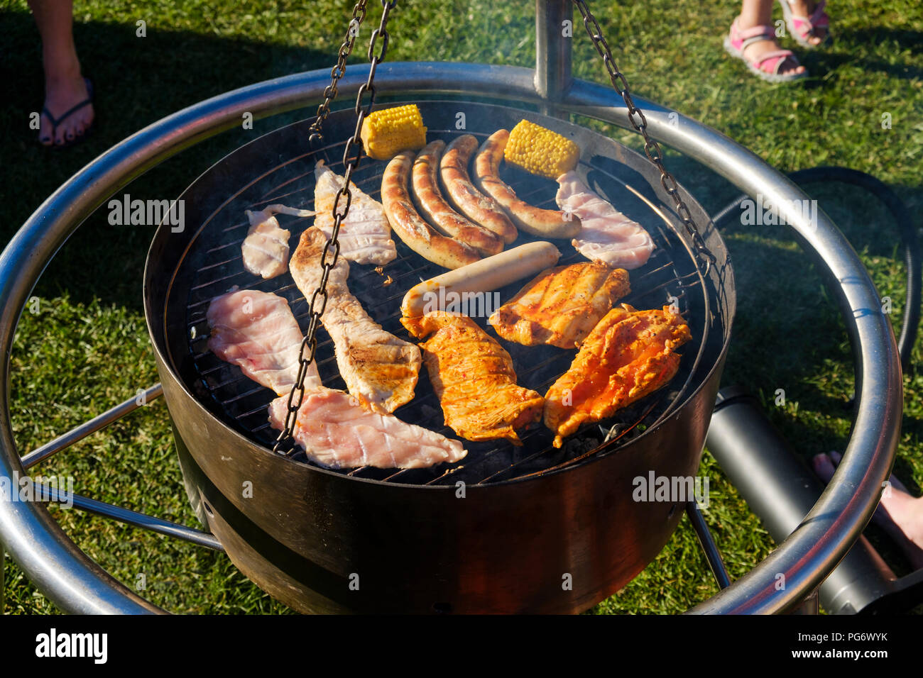 Meet and sausages on barbecue grill - Stock Image