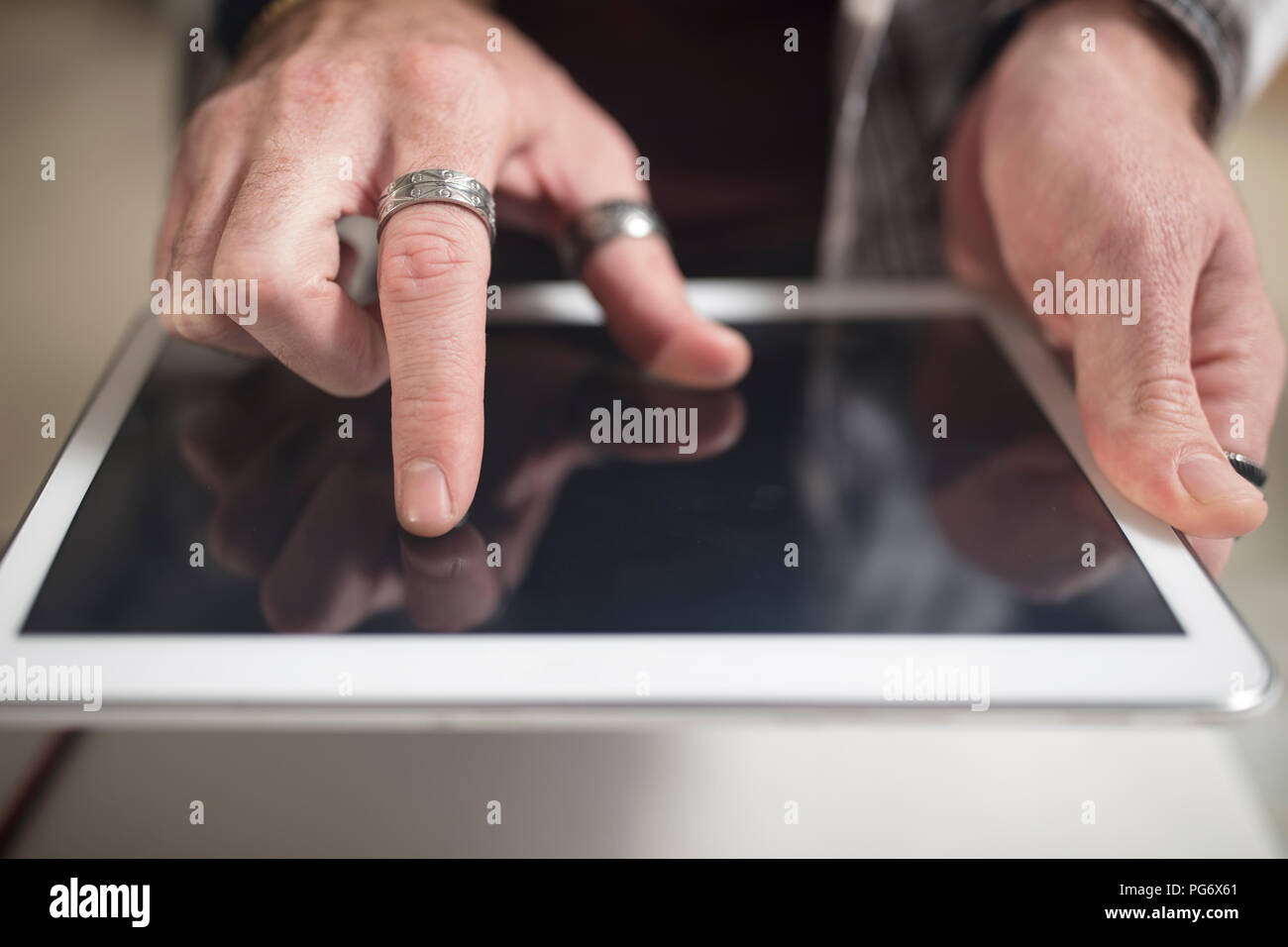 Close-up of man using tablet - Stock Image