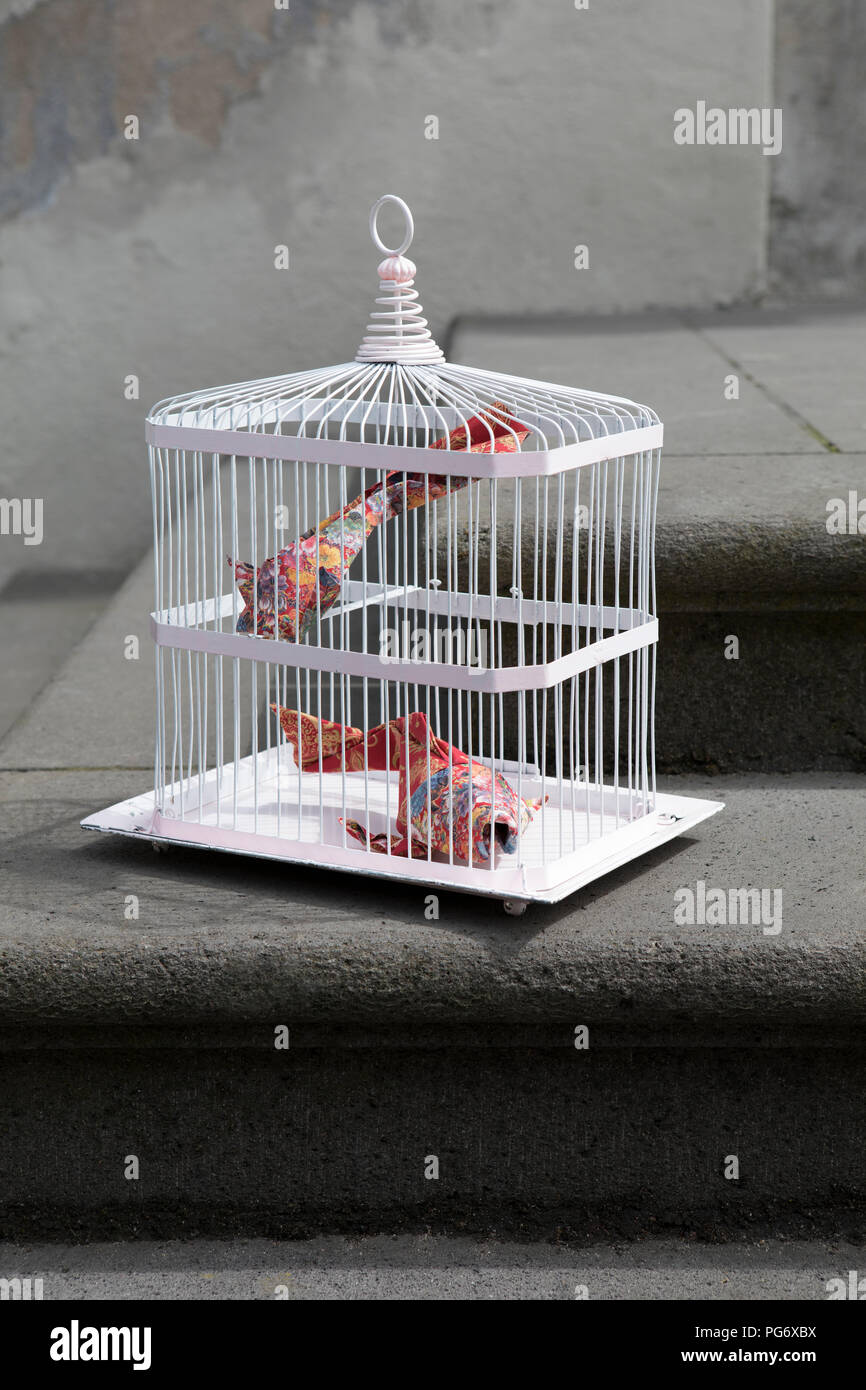 Origami cois in cage - Stock Image