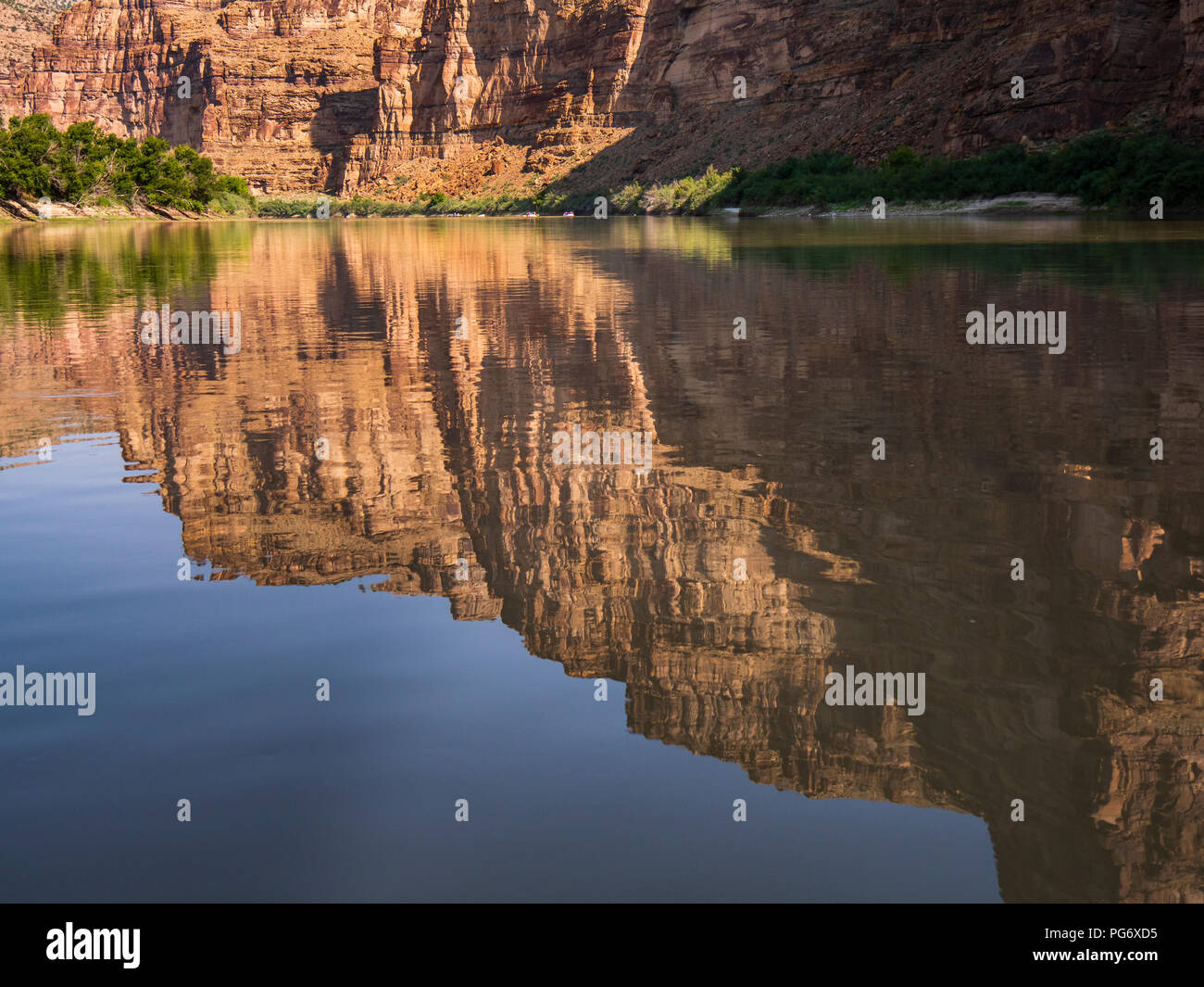 Cliffs reflecting in the water, upper Desolation Canyon north of Green River, Utah. - Stock Image