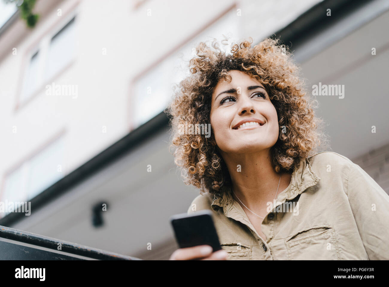 Woman in the city using smartphone Stock Photo