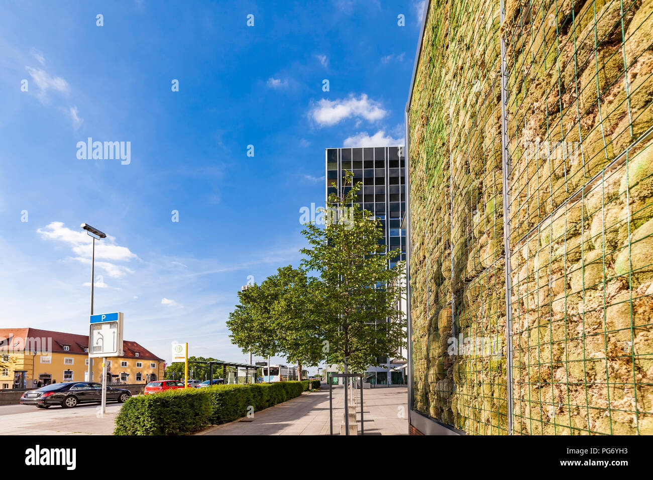 Germany, Stuttgart, wall with moss near bus station, air pollution control - Stock Image