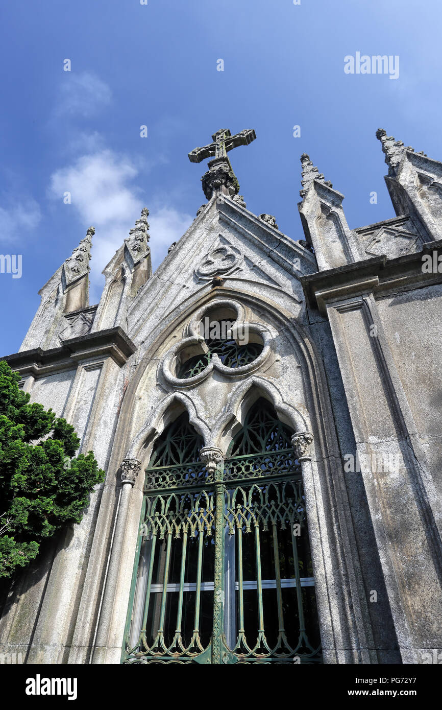 Old granite traditional portuguese middle class family vault in the form of chapel - Stock Image