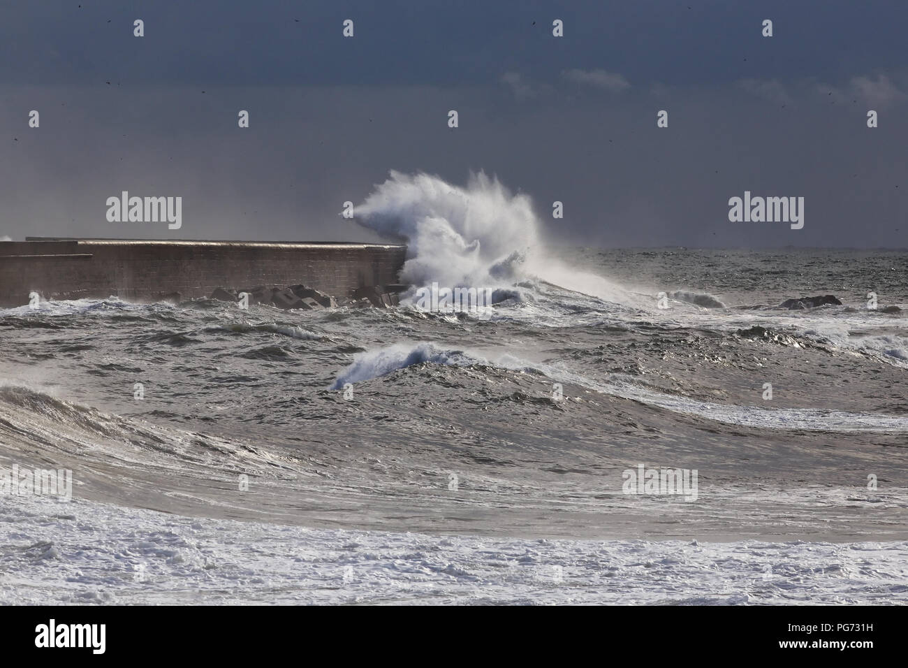 Big stormy waves against Leixoes harbor north wall Stock Photo