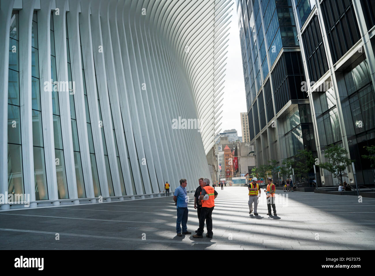 Tower 3 at the World Trade Center site opened on June 11, 2018 across from the transportation hub known as the Oculus. - Stock Image