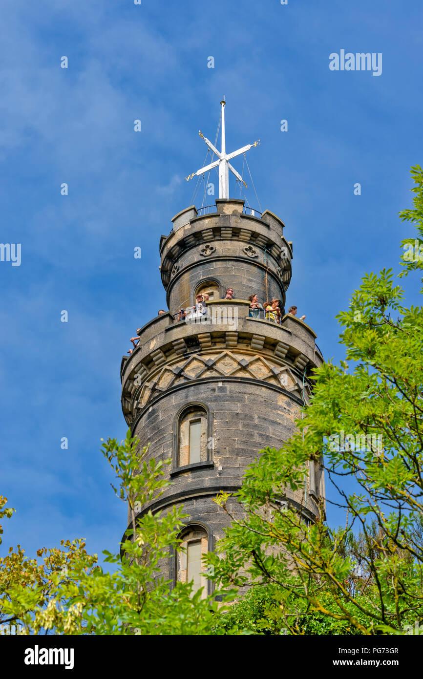 EDINBURGH SCOTLAND CALTON HILL NELSON TOWER WITH TOURISTS - Stock Image