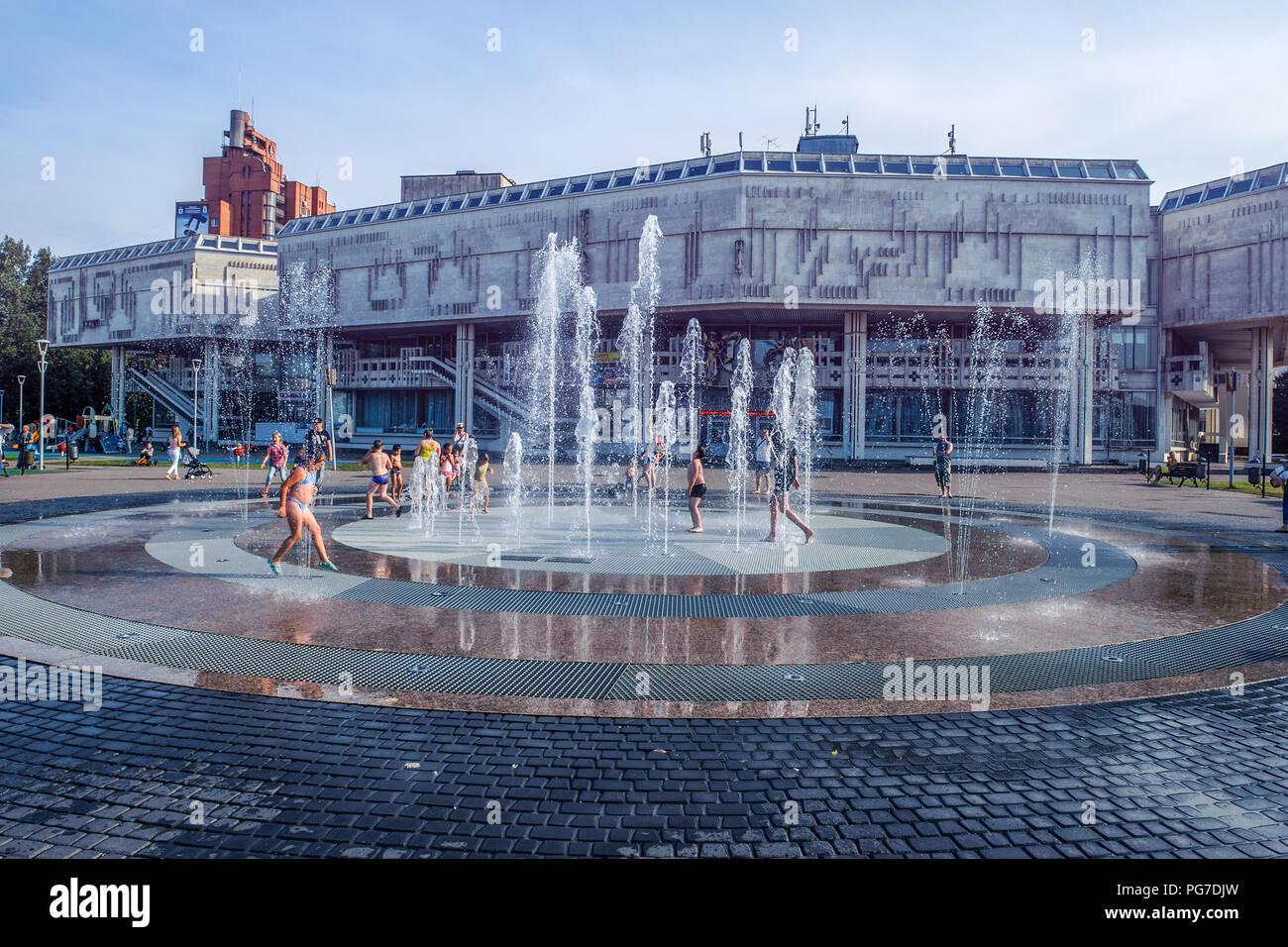 Russia, Yaroslavl August 04 2018 . Children swim in the street in the fountain in hot weather. Extreme heat - Stock Image