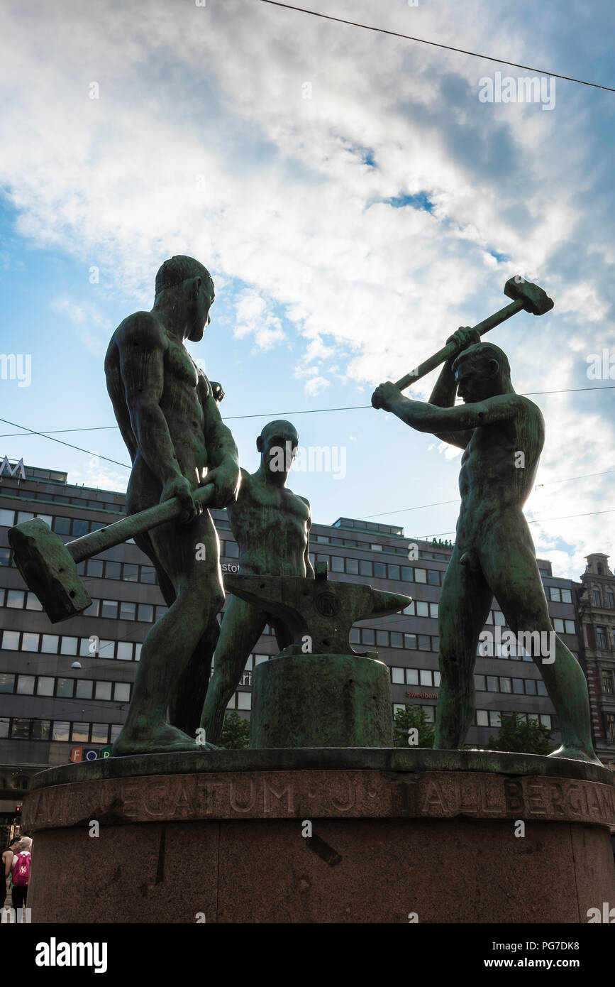 The famous Helsinki statue titled 'The Three Smiths' sited between Aleksanterinkatu and Mannerheimintie in the city center, Finland. - Stock Image