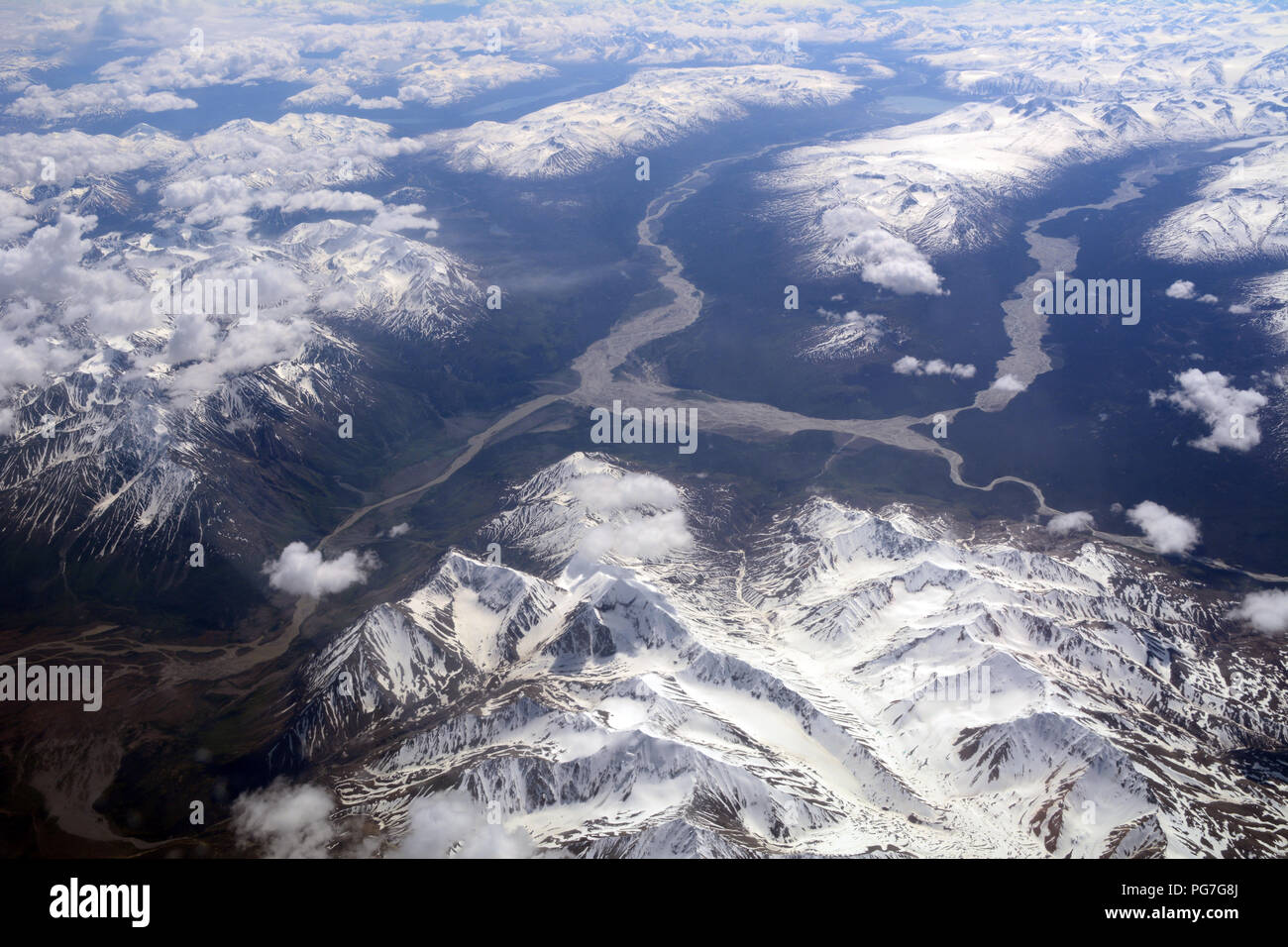 An aerial view of glacial runoff and rivers originating in the icefieds of the St. Elias Mountains, Kluane National Park, Yukon Territory, Canada. - Stock Image