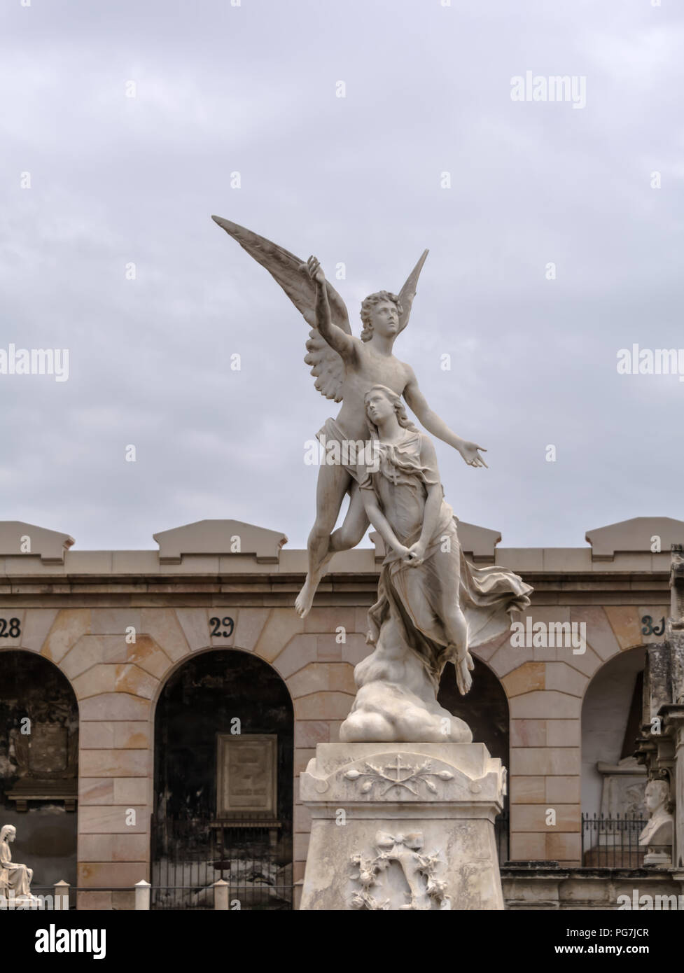 Neoclassic sculpture of a winged angel raising the swooning soul of a maiden to heaven. The statue, carved by Fabiesi, dates to 1880 - Stock Image