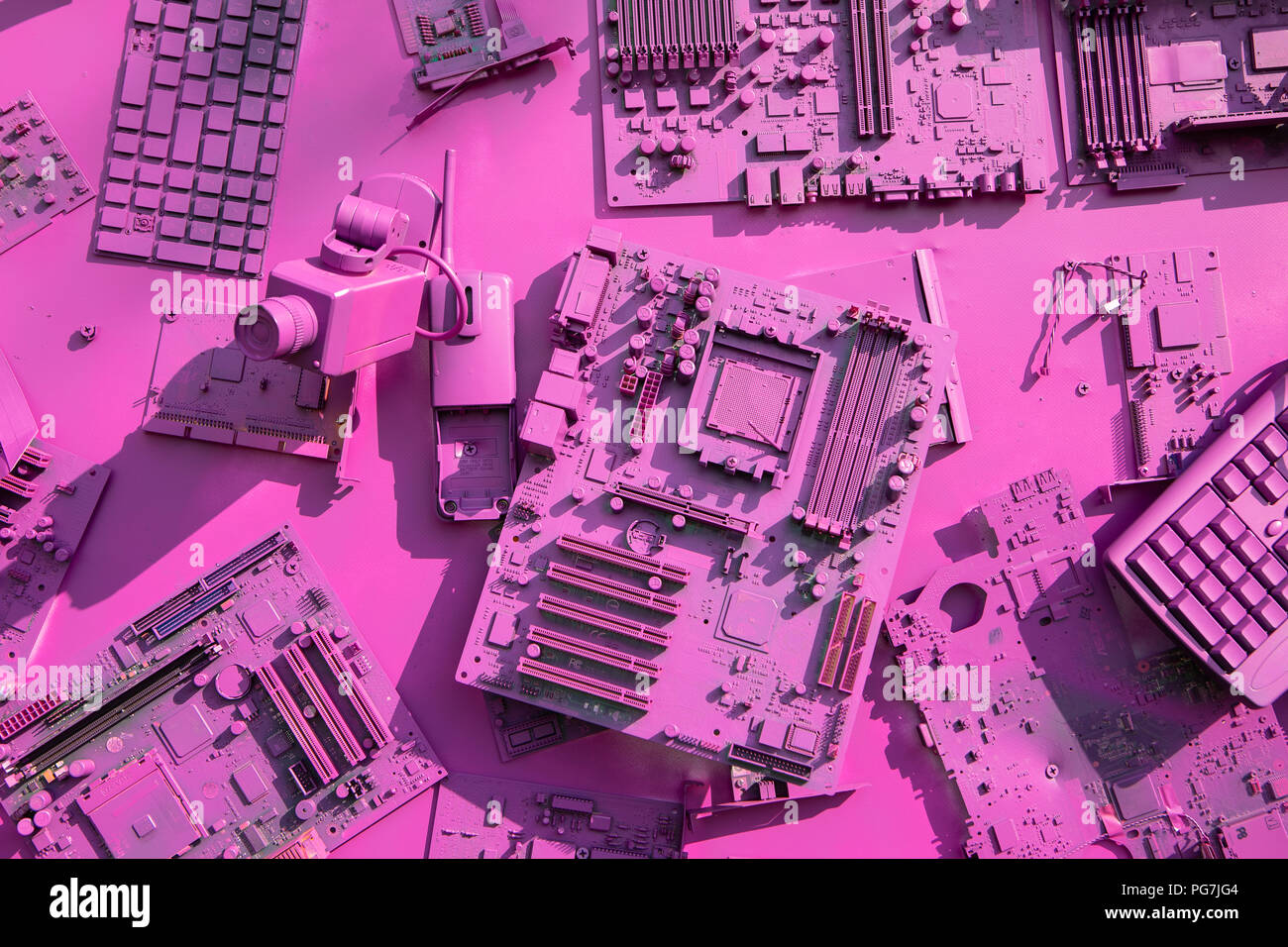 a collage of old computer components in purple color stock photo