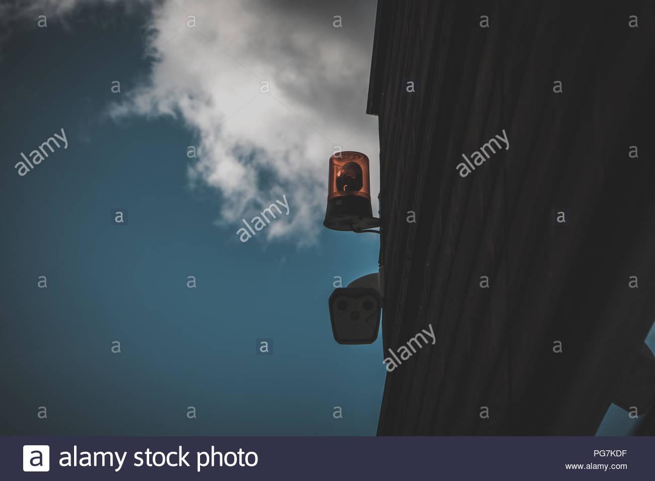 Surveillance Camera, Security Camera at a house facade, concept image, urban photography dark Stock Photo