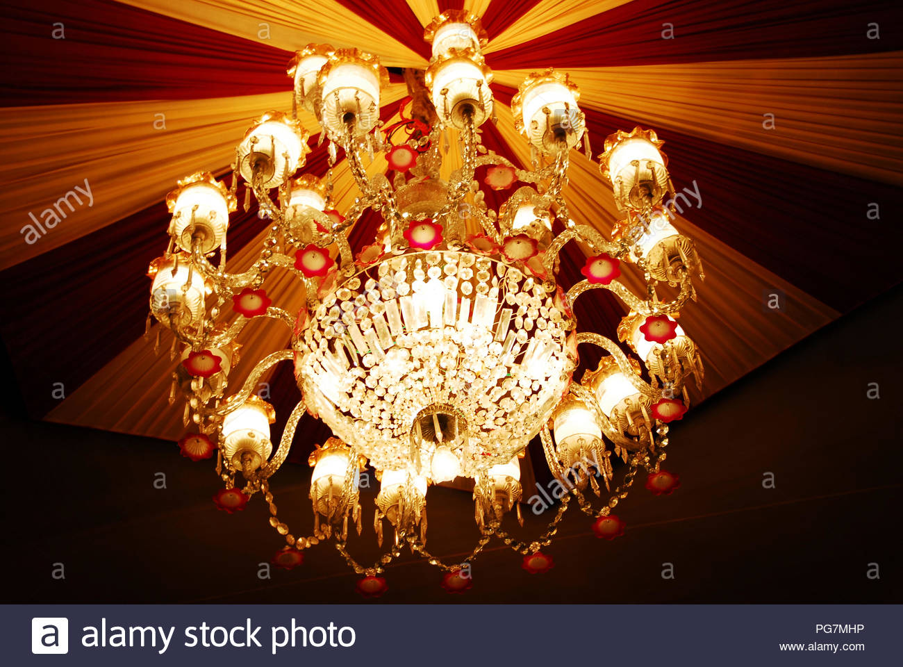 isolated shot of Home interiors Chandelier on ceiling - Stock Image