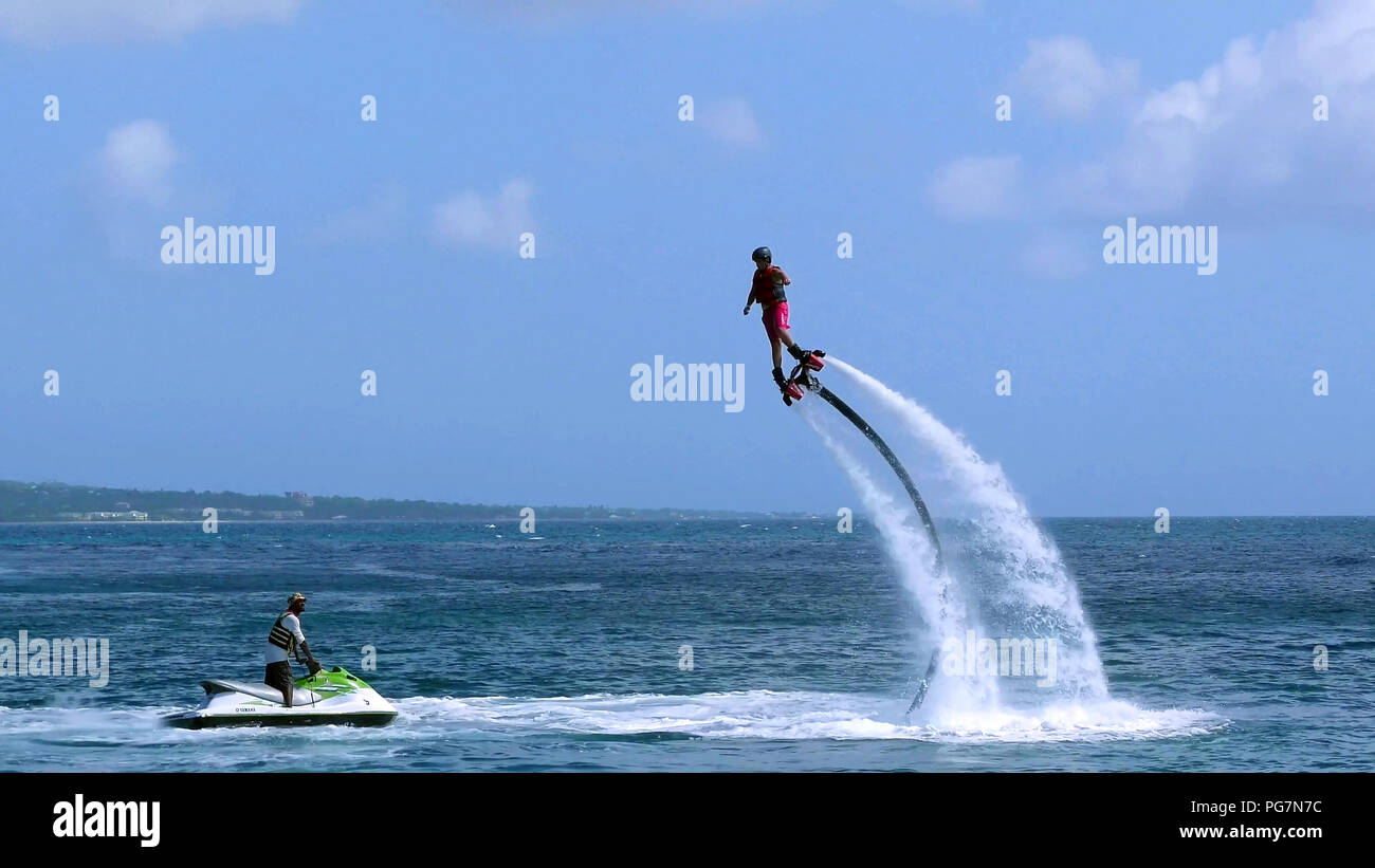Man flying on Jetpack boots Stock Photo