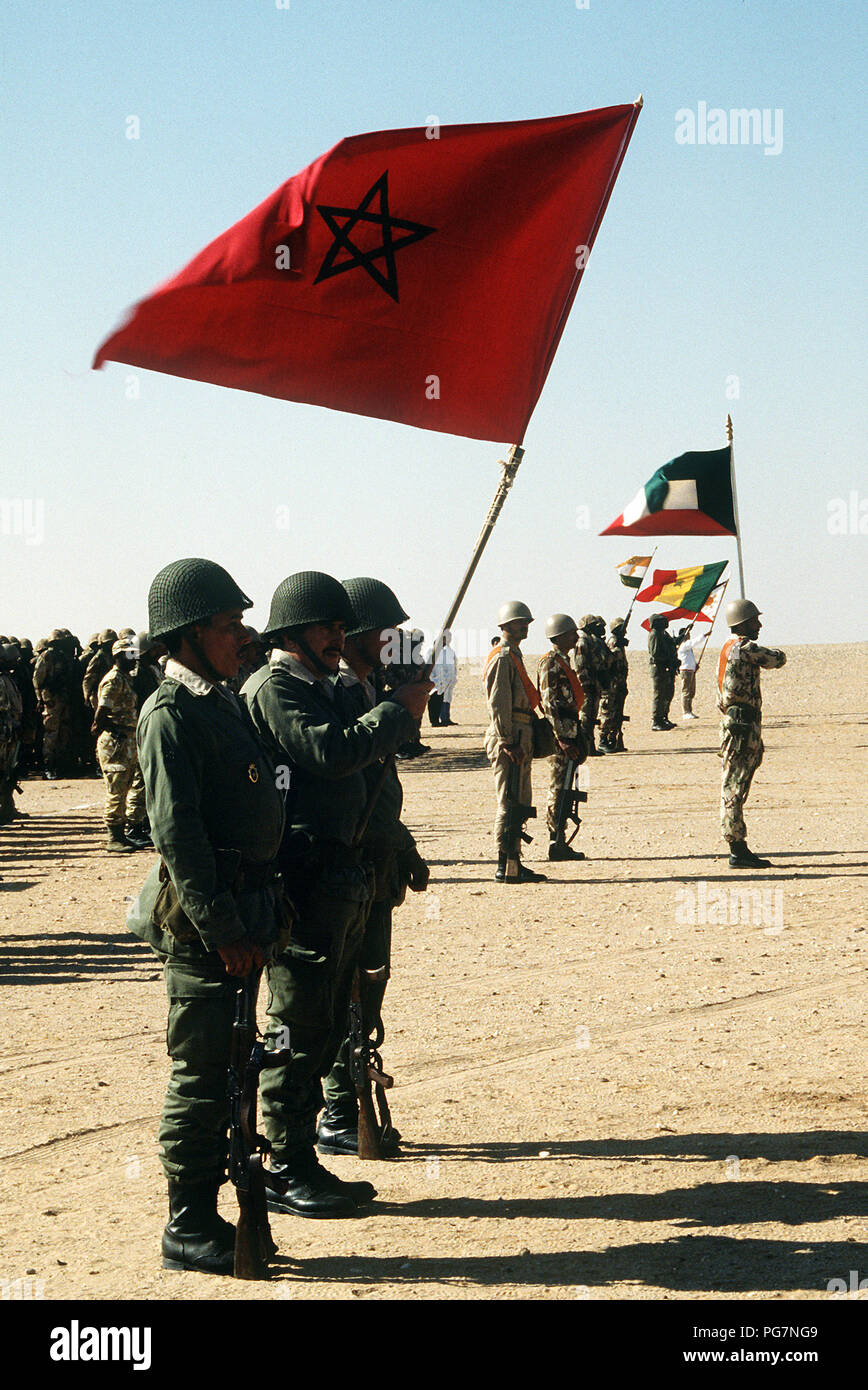 Troops from Morocco, Kuwait, Niger and Senegal, along with a medical unit from China, gather for review by King Fahd of Saudi Arabia.  The units are taking part in an assembly of  international coalition forces united against Saddam Hussein during Operation Desert Storm. - Stock Image
