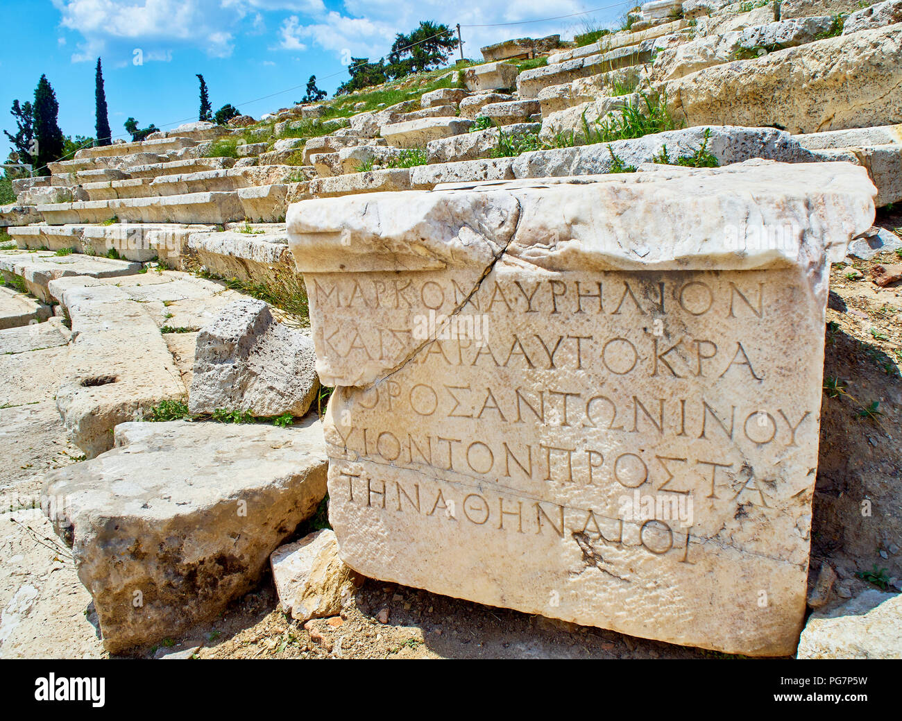 Remains of carved pedestal stone of the Theatre of Dionysus Eleuthereus. Acropolis of Athens. Attica region, Greece. - Stock Image