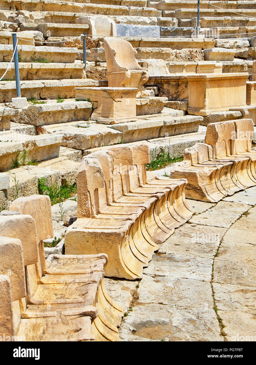 Marble thrones of the Theatre of Dionysus Eleuthereus. Acropolis of Athens. Attica region, Greece. - Stock Image