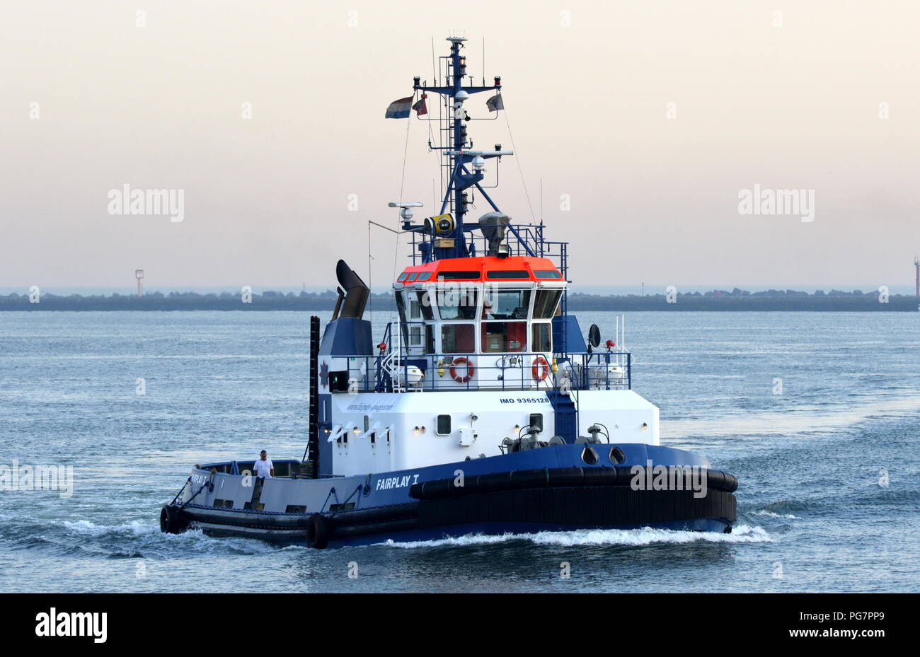 The harbor tug Fairplay I operates on 27 July 2018 in the port of Rotterdam. - Stock Image