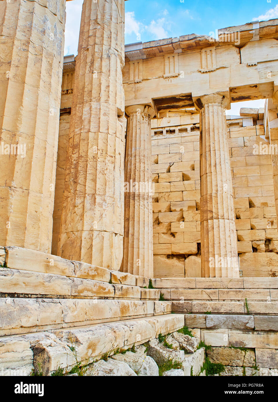 Doric columns and Entabulature of the western facade of Propylaea, the ancient gateway to the Athenian Acropolis. Athens. Attica, Greece. - Stock Image