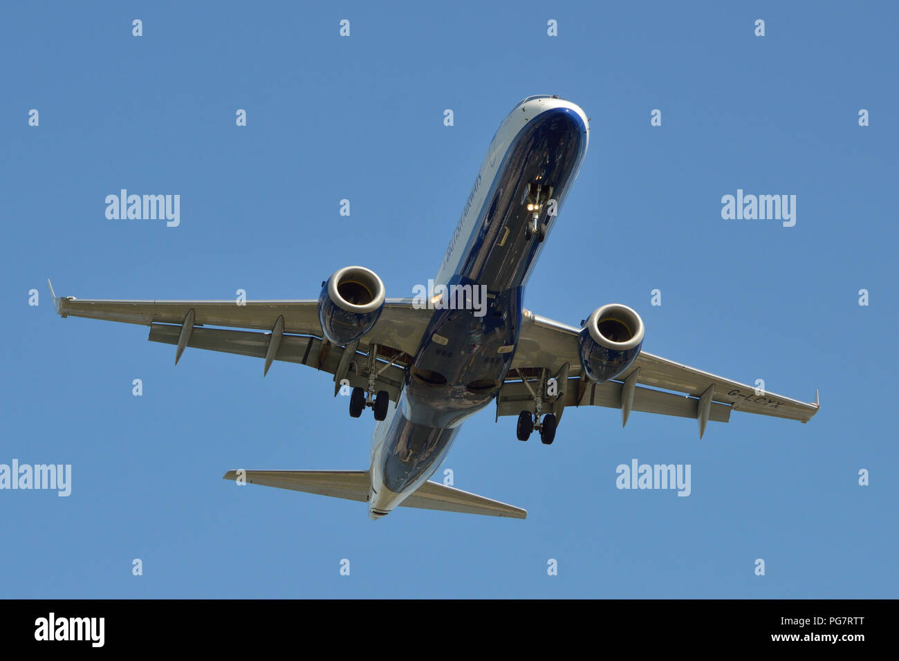 A British Airways CityFlyer Embraer 190 comes in to land at London City Airport in London's Docklands - Stock Image