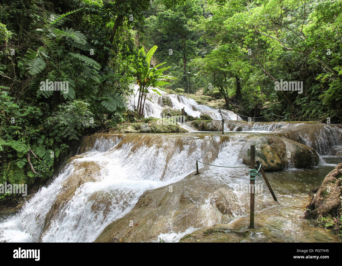 Mele cascades are located on Efate in Vanuatu and are a popular tourist destination where people can enjoy the scenery and a swim in the refreshing wa - Stock Image