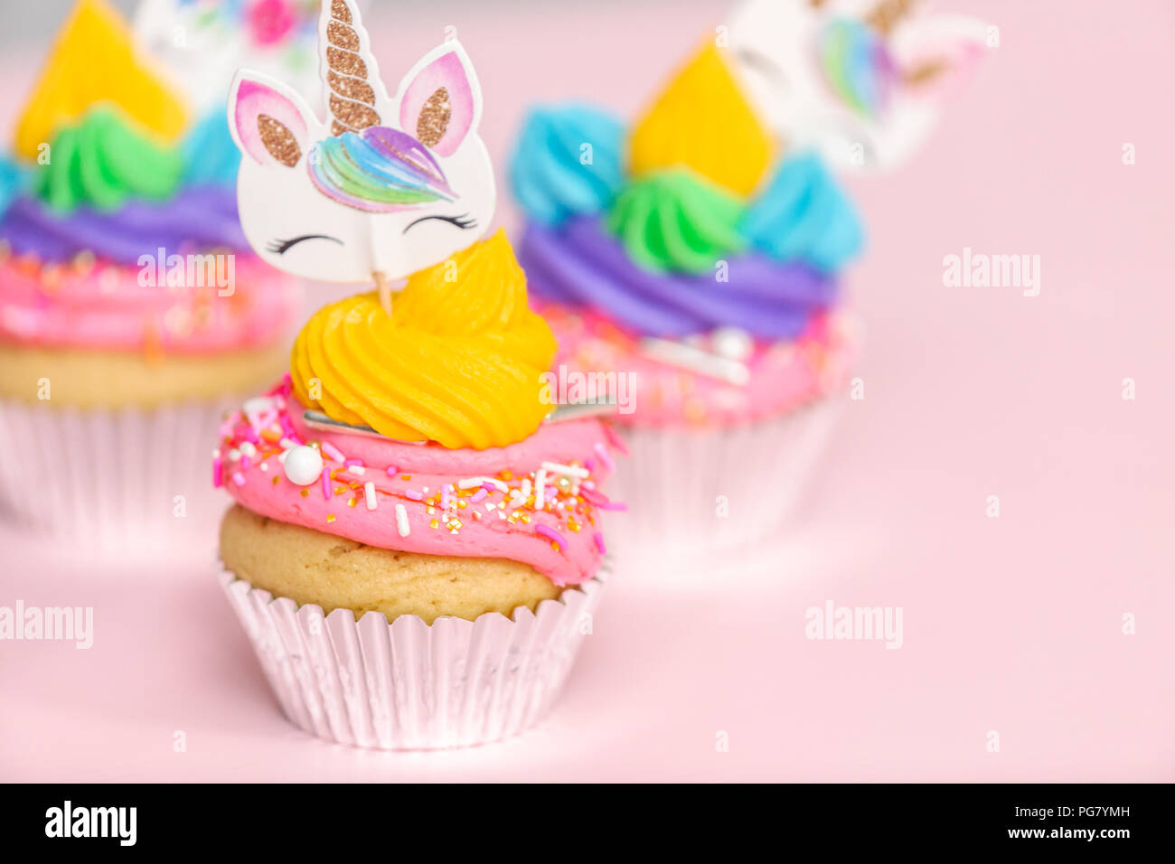 Fancy unicorn cupcakes with multicolor buttercream icing and