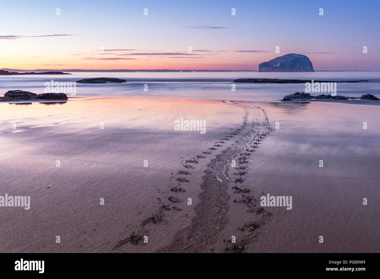 UK, Scotland, East Lothian, North Berwick, Firth of Forth, view of Bass Rock (world famous Gannet Colony) at sunset, Lighthouse, long exposure, sea mo Stock Photo