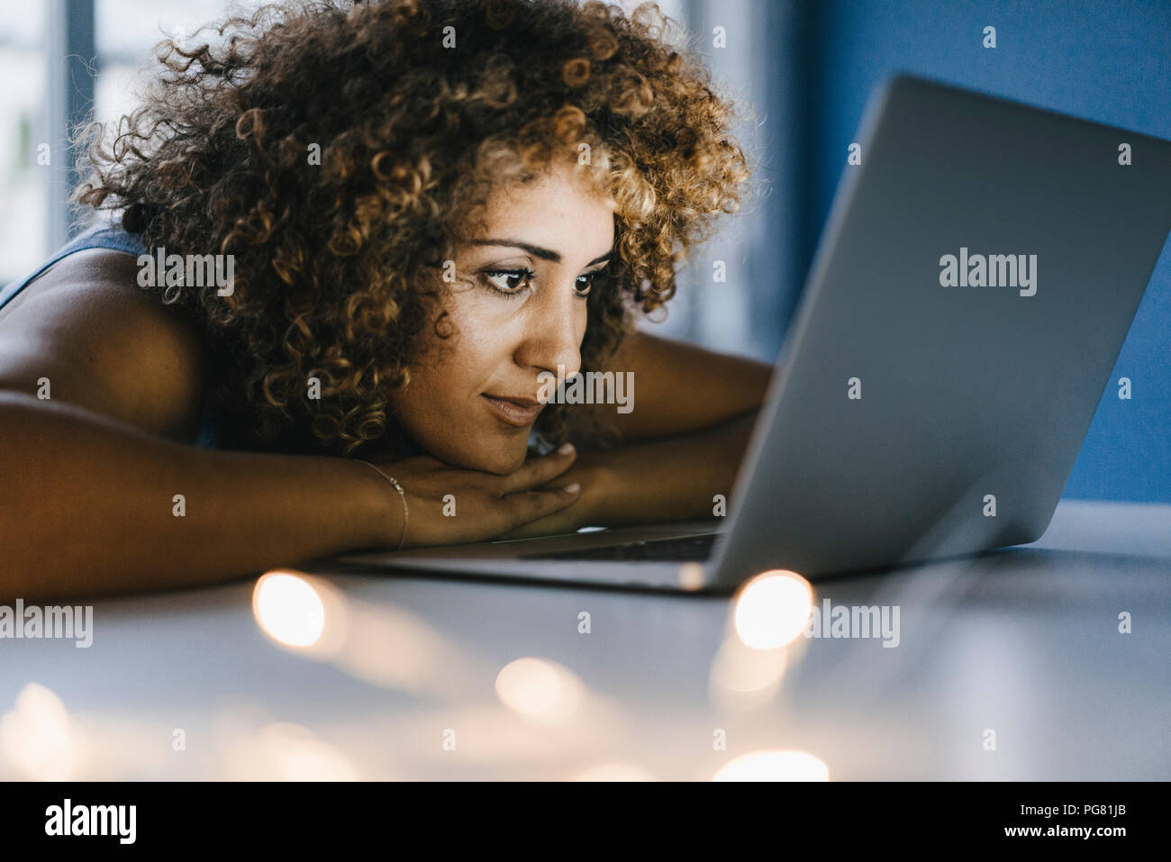 Woman working overtime in her start-up business - Stock Image