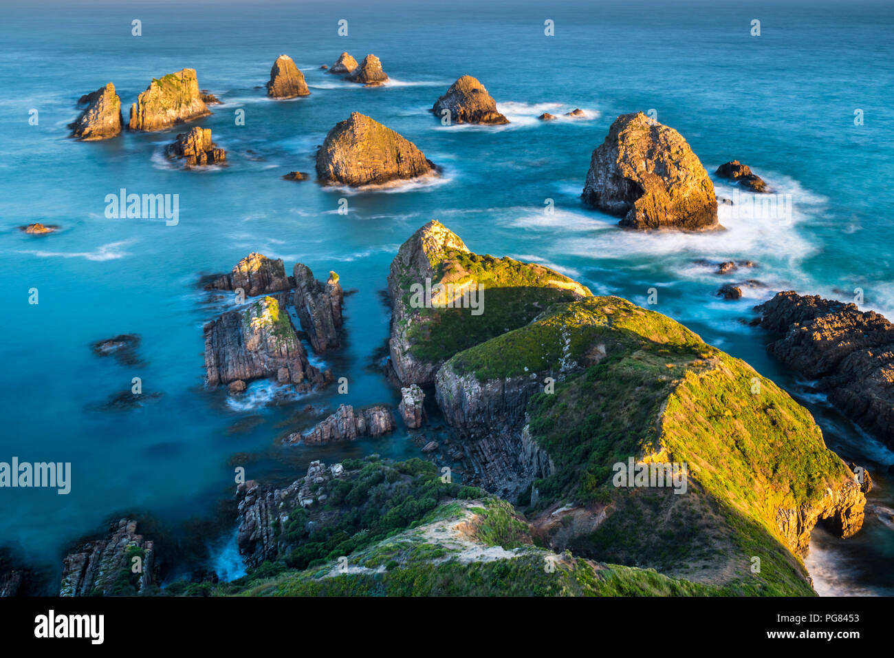 New Zealand, South Island, Southern Scenic Route, Catlins, sunset at Nugget Point - Stock Image