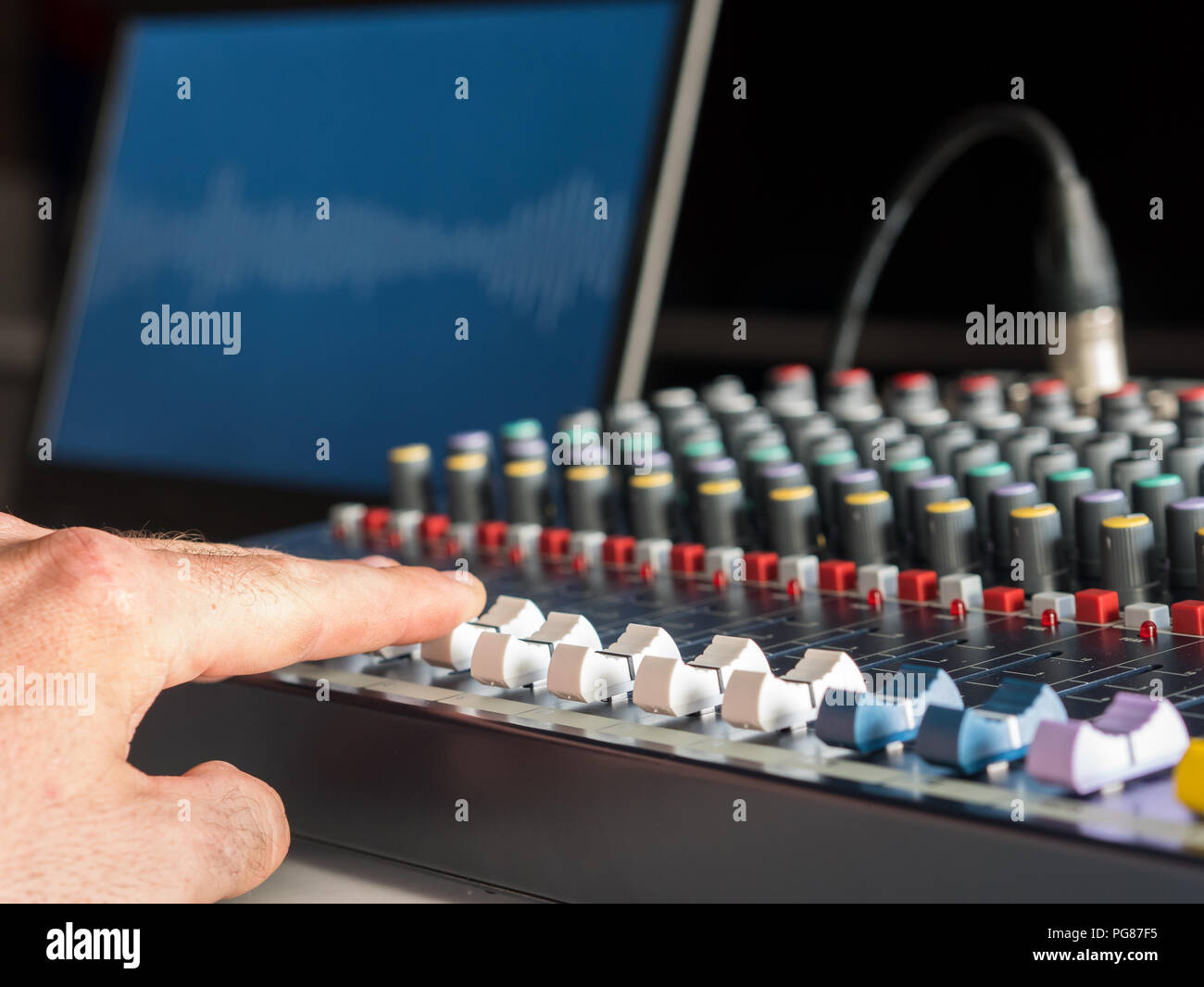 Man working on audio equipment in radio station Stock Photo