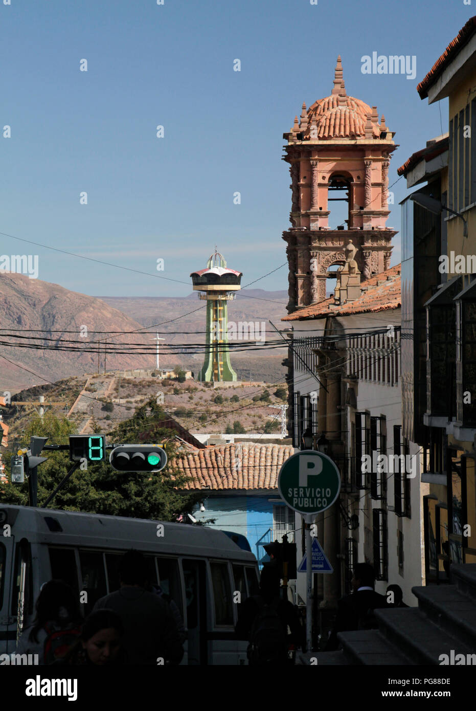 Potosi, Bolivia - June 10 2016: Pedestrians and vehicles going down a road in the city center of Potosi, Bolivia - Stock Image