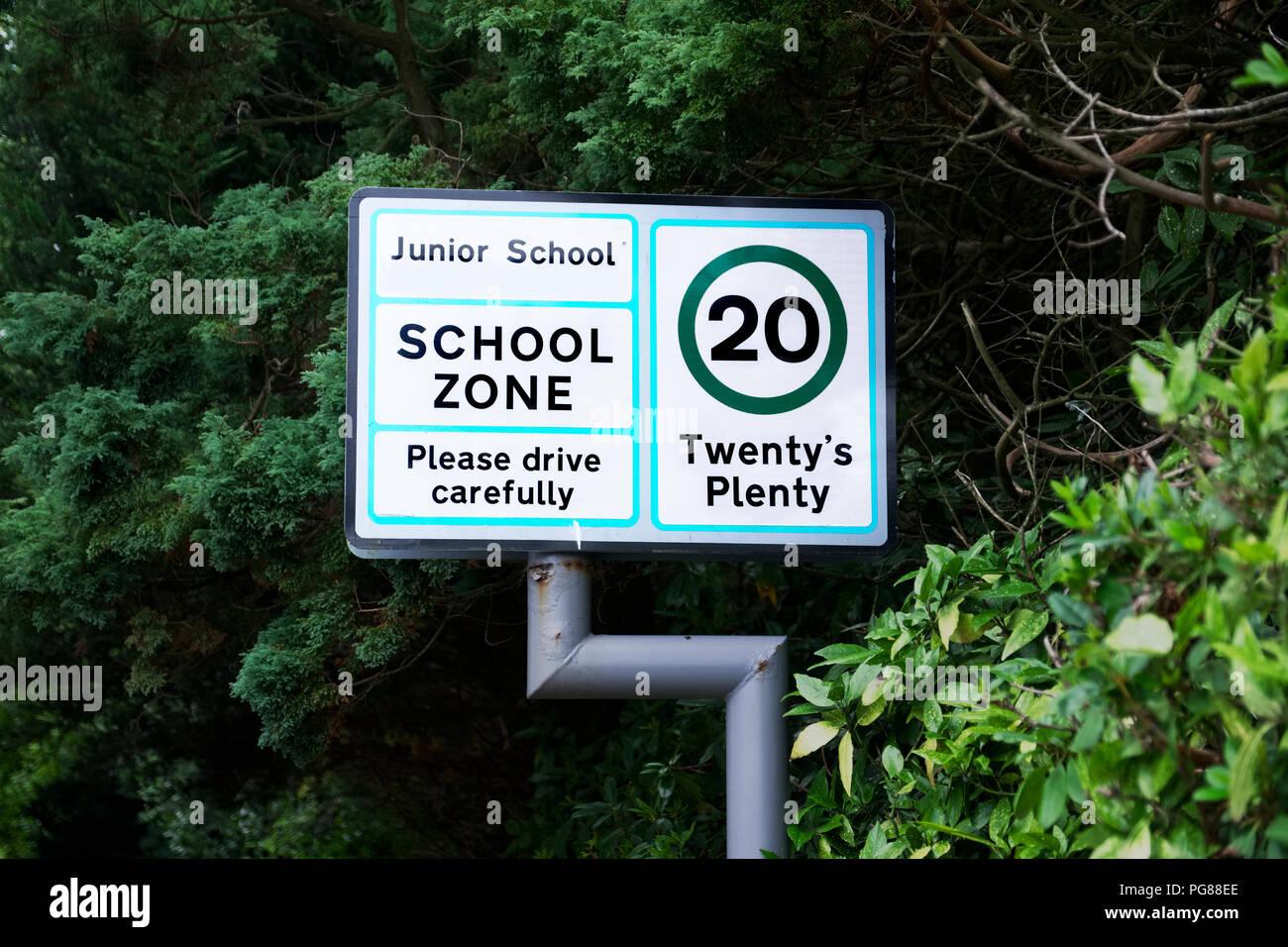 School zone twenty plenty please drive carefully sign - Stock Image