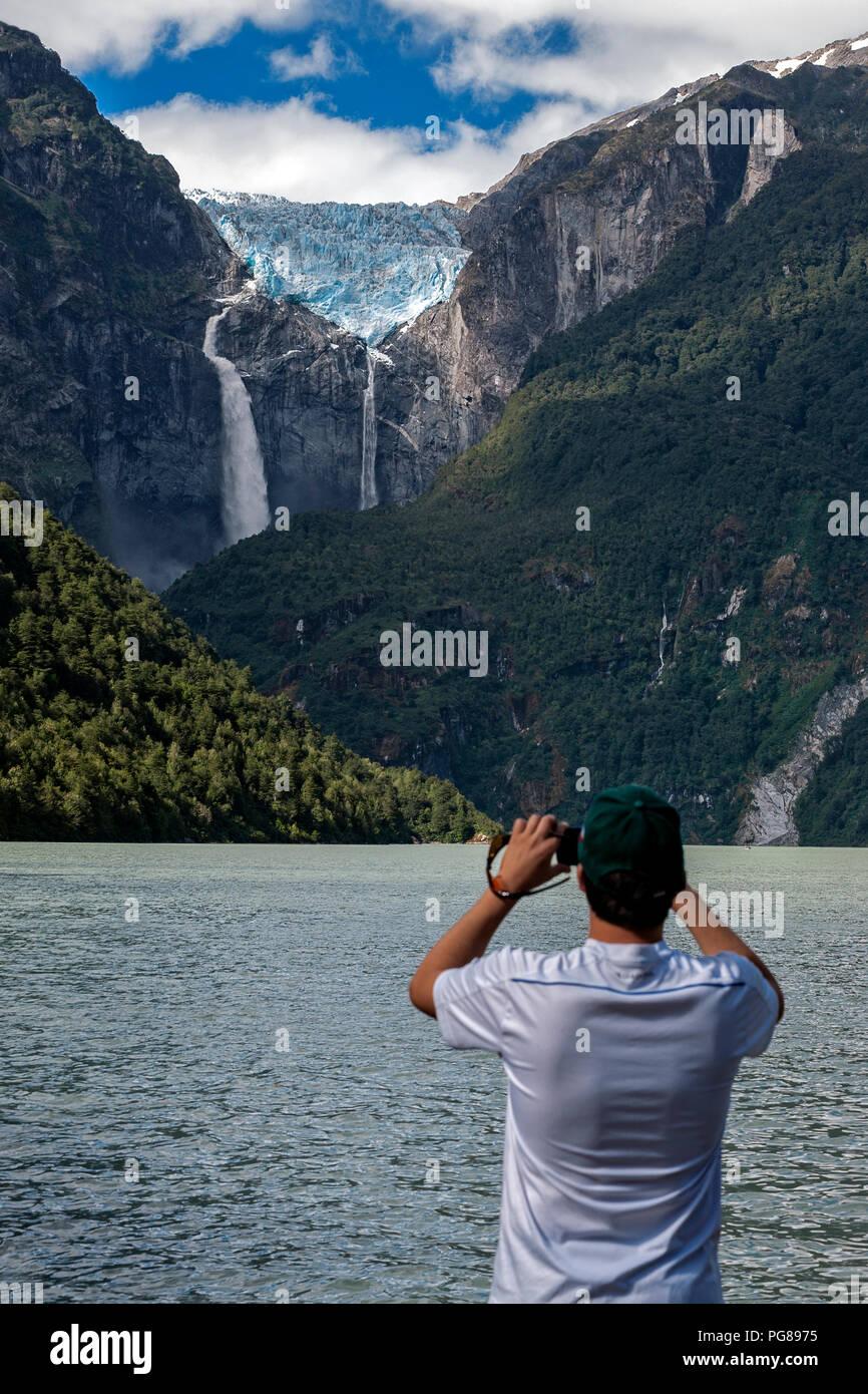Tourist photographing the Ventisquer colgante (hanging glacier).Queulat National Park.Aysén region.Chile - Stock Image