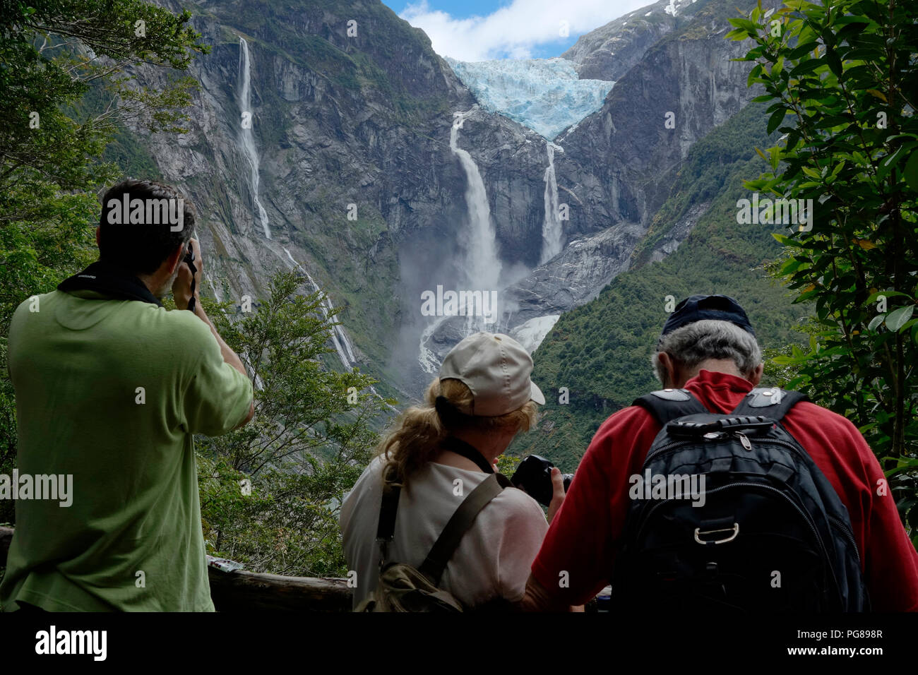 Tourists photographing the Ventisquero colgante (hanging glacier).Queulat National PArk.Aysén region.Chile - Stock Image