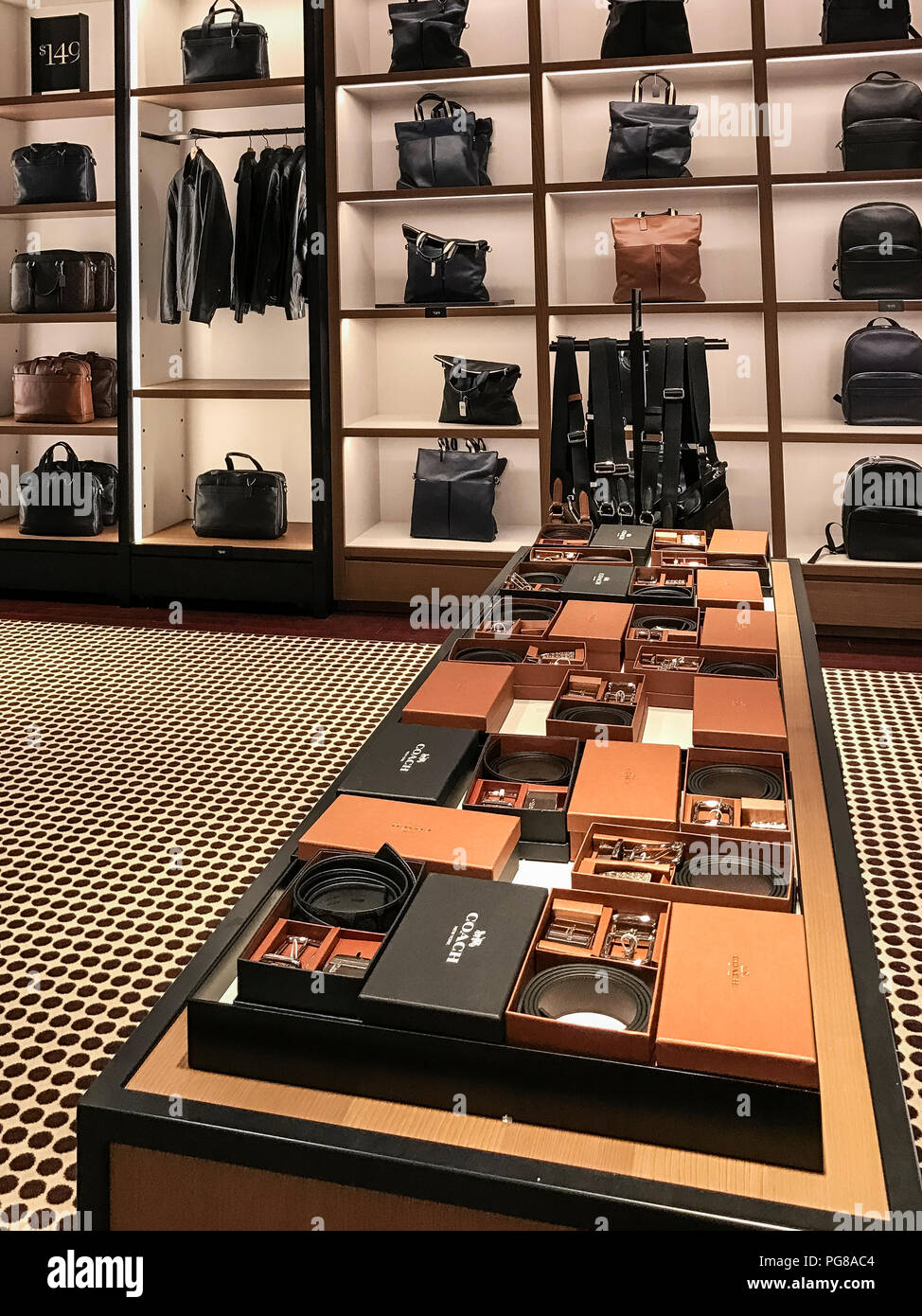 Men's product display in a Coach Store, Atlantic City, New Jersey, USA. - Stock Image