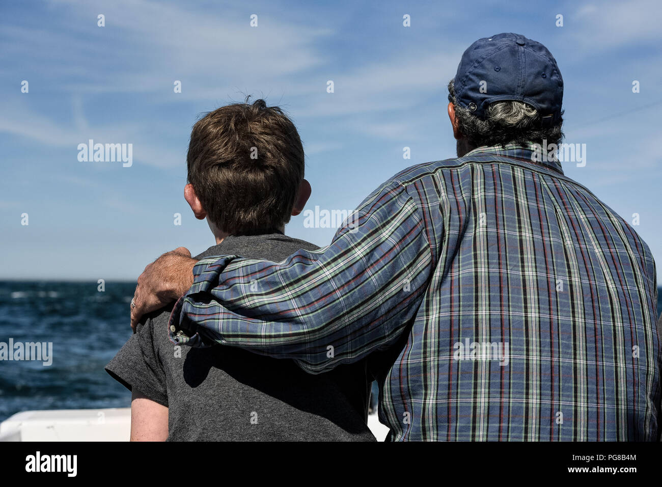 Father and son bonding on a charter fishing trip. - Stock Image
