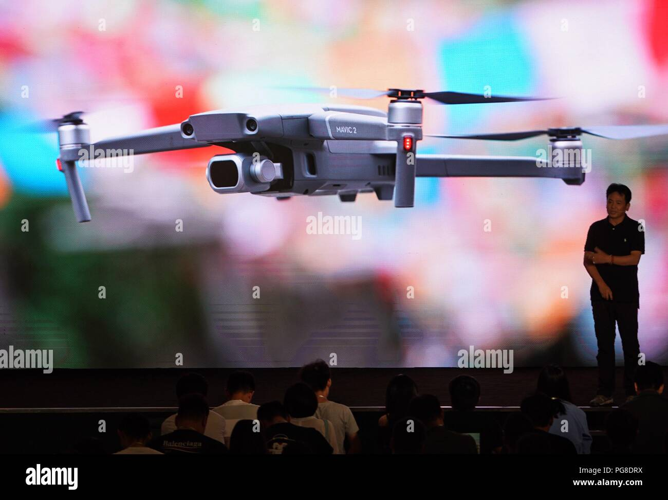 Beijing, China. 24th Aug, 2018. A photographer introduces his experience of the newly-released DJI Mavic 2 Pro drone during a launching event in Beijing, capital of China, Aug. 24, 2018. Chinese drone manufacturer DJI released its new Mavic drone Friday. Credit: Xing Guangli/Xinhua/Alamy Live News - Stock Image