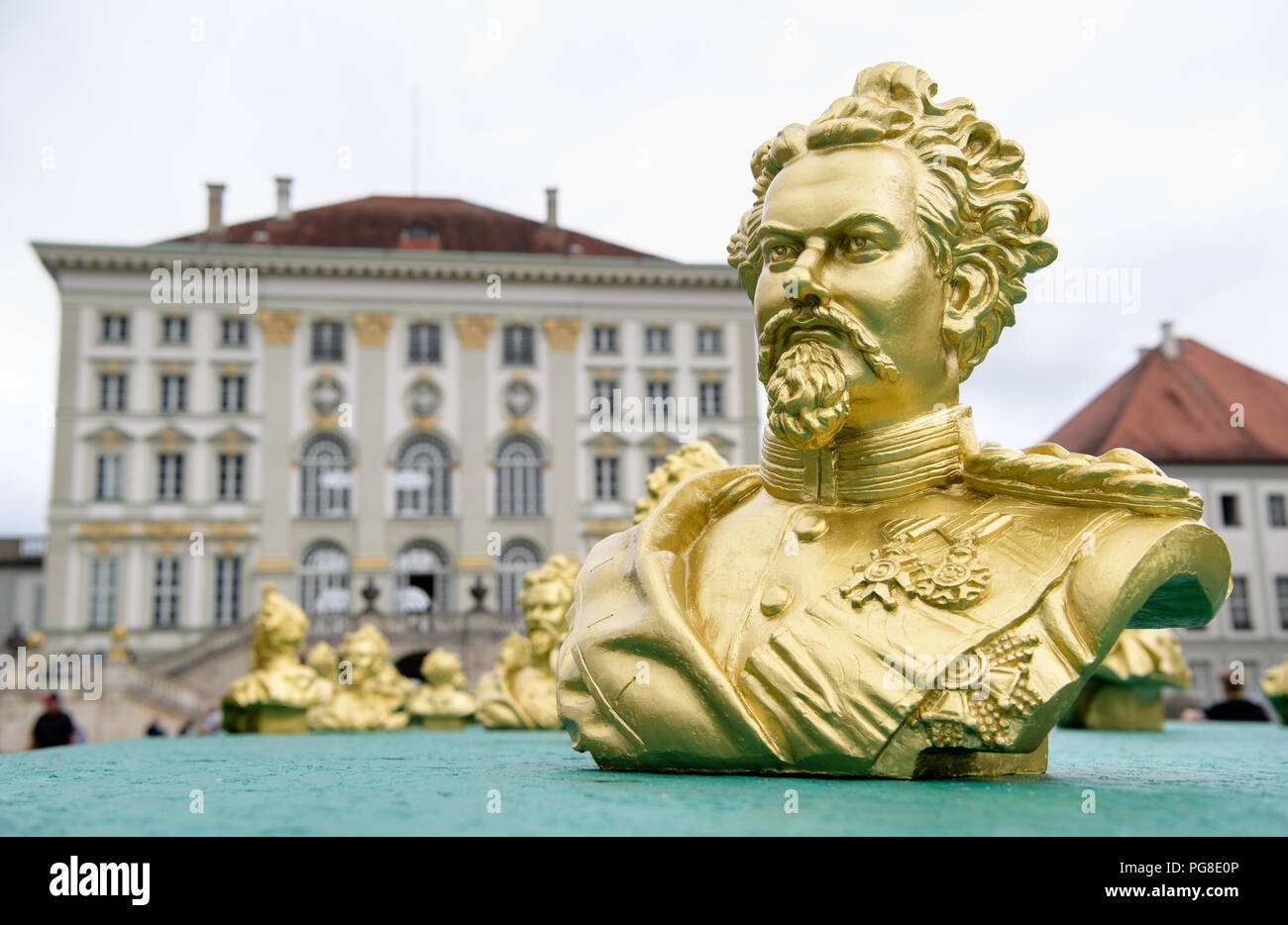 Munich, Germany. 24th Aug, 2018. An art installation in honour of the fairy-tale king Ludwig II. by Nuremberg concept artist Hörlist can be seen in Nymphenburg Palace Park. 100 images of Ludwig II were set up in the context of the art installation one day before Ludwig's 173rd birthday. Credit: Matthias Balk/dpa/Alamy Live News - Stock Image