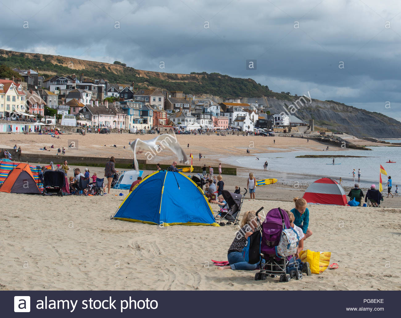 7ba6599938 UK Weather  Visitors enjoy bright sunny spells and a fresh breeze at the  beach at Lyme Regis which was much quieter at the start of ...