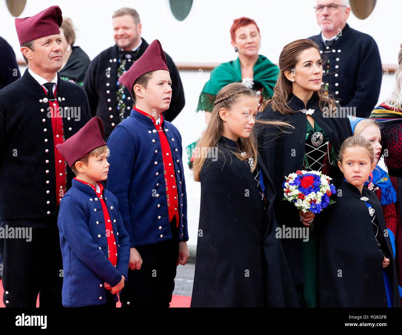Faroe Islands. 24th Aug, 2018. Crown Prince Frederik, Crown Princess Mary, Prince Christian, Princess Isabella, Prince Vincent and Princess Josehpine of Denmark arrive with the The Royal Ship, HDMY Dannebrog at the harbour of Klaksvík, on August 24, 2018, on the 2nd of the 4 days visit to the Faroe Islands Photo : Albert Nieboer/ Netherlands OUT/Point de Vue OUT | Credit: dpa picture alliance/Alamy Live News - Stock Image