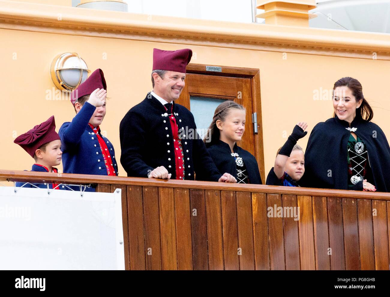 Faroe Islands. 24th Aug, 2018. Crown Prince Frederik, Crown Princess Mary, Prince Christian, Princess Isabella, Prince Vincent and Princess Josehpine of Denmark arrive with the The Royal Ship, HDMY Dannebrog at the harbour of Klaksv?k, on August 24, 2018, on the 2nd of the 4 days visit to the Faroe Islands Photo : Albert Nieboer/ Netherlands OUT/Point de Vue OUT | Credit: dpa picture alliance/Alamy Live News - Stock Image
