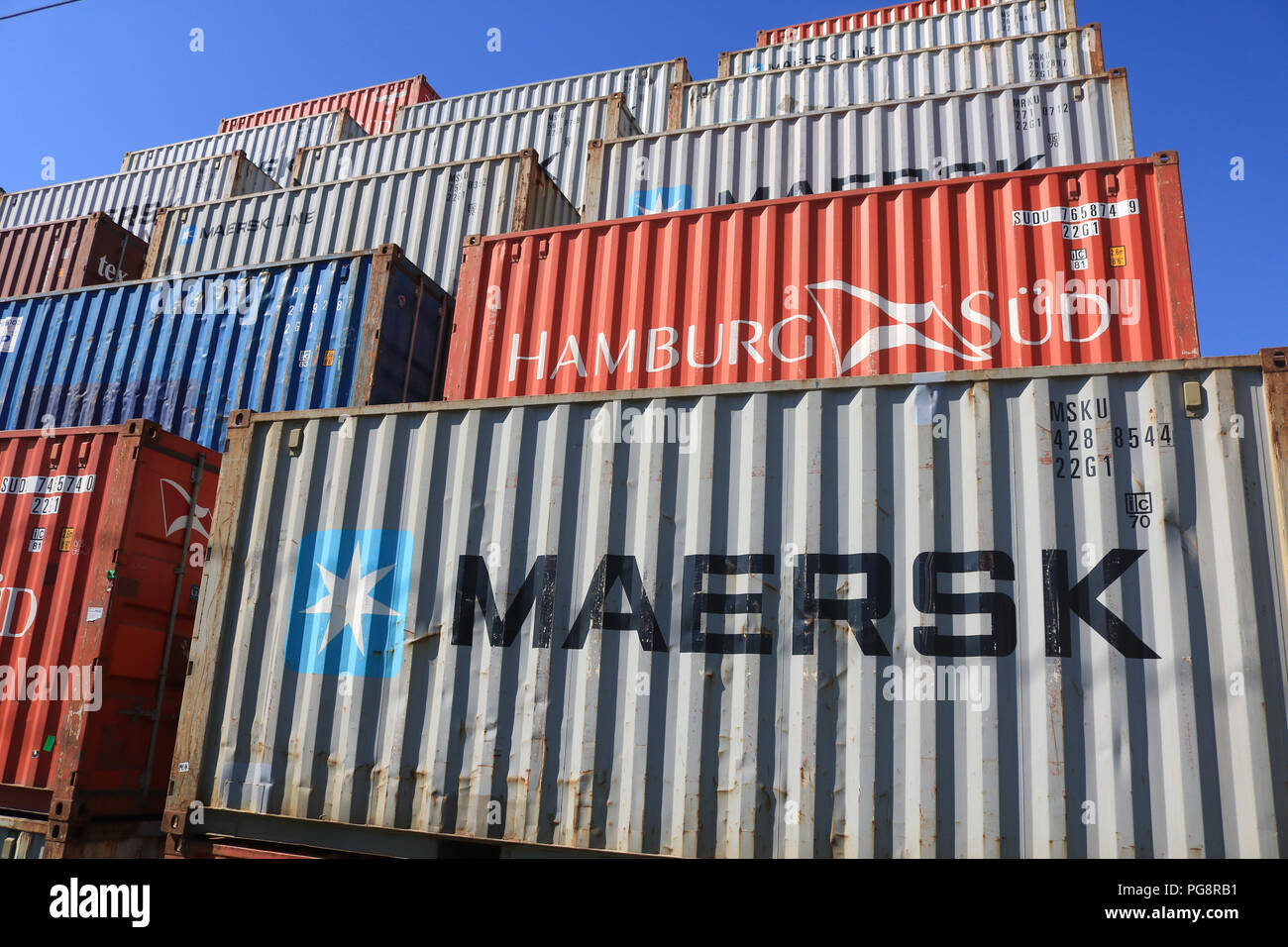 Shipping Containers Against Blue Sky Stock Photos & Shipping