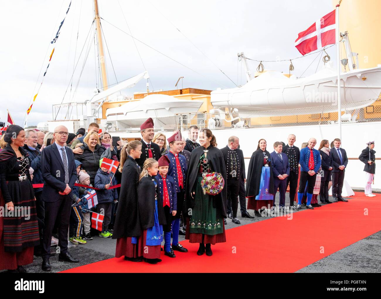 Glyvrar, Faroe Islands, Denmark. 25th Aug, 2018. Crown Prince Frederik, Crown Princess Mary, Prince Christian, Princess Isabella, Prince Vincent and Princess Josehpine of Denmark arrive with the The Royal Ship, HDMY Dannebrog at Bakkafrost in Glyvrar, on August 25, 2018, on the 3rd of the 4 days visit to the Faroe Islands Photo : Albert Nieboer/ Netherlands OUT/Point de Vue OUT | Credit: dpa/Alamy Live News - Stock Image